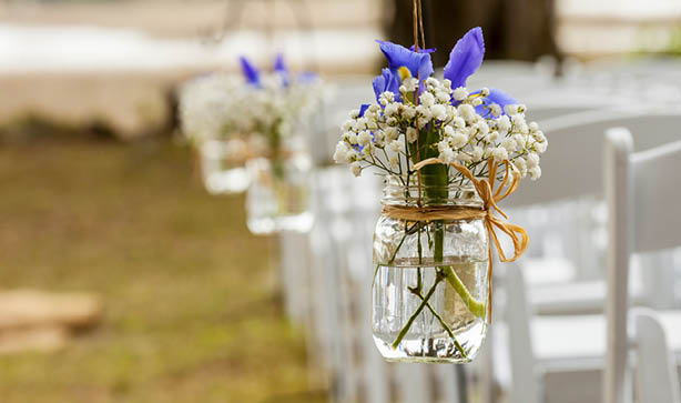 Mason jar floral arrangements are great for budget weddings