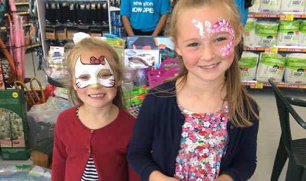 Two little girls in our Aylesford store with their faces painted