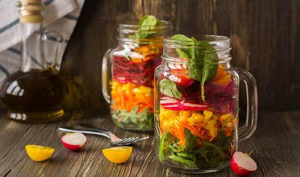 Two Mason Jars filled with salad
