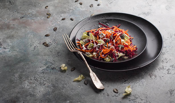 A bowl of tasty carrot and beetroot salad