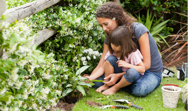 A mother an her child gardening together