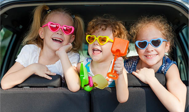 Three Cute Ginger Red Haired Children Wearing Heart Sunglasses In Car