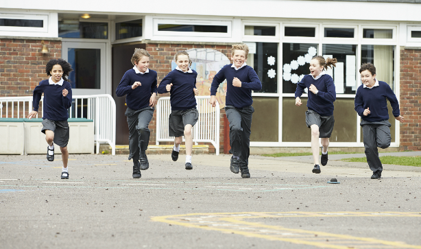 School kids running in the playground