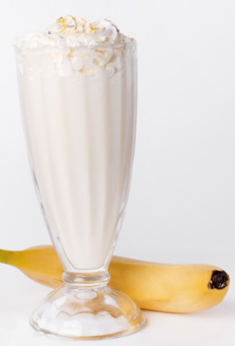 vanilla milkshake with whipped cream at the top