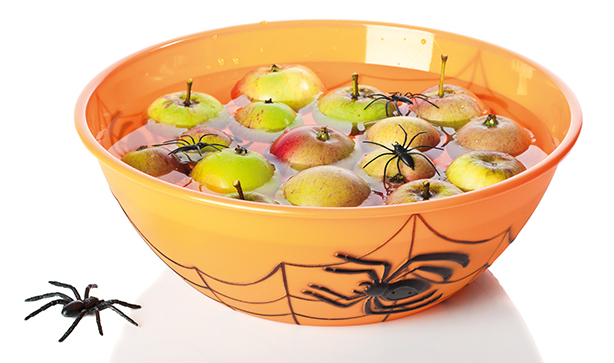 bowl of water filled with apples and covered with spider web design