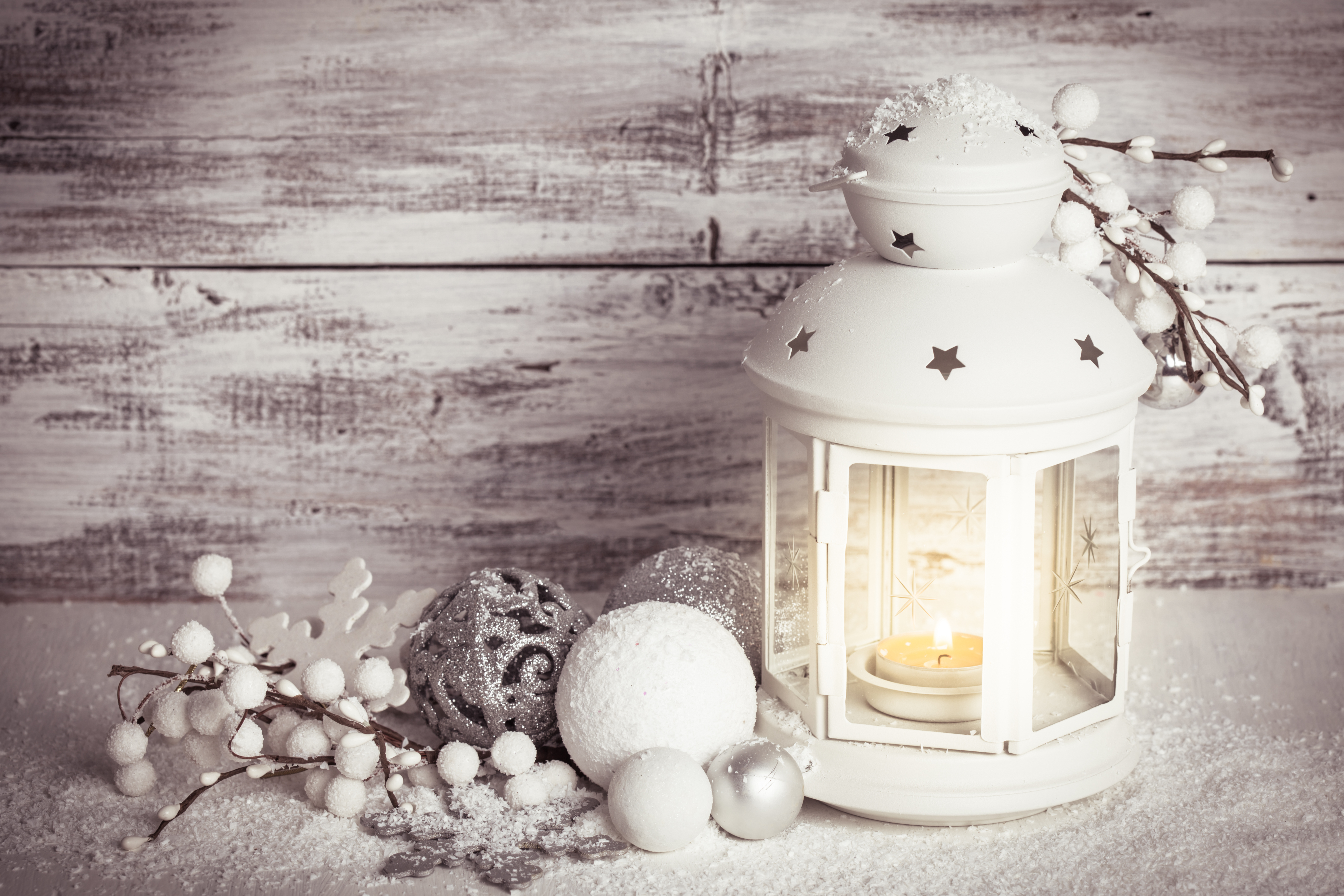 Christmas lantern with pine cones and berries