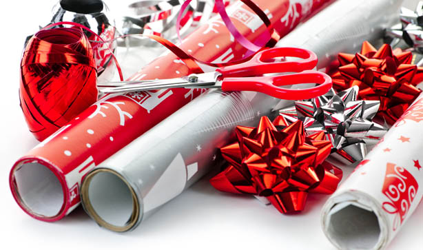 Christmas wrapping paper, scissors and ribbons