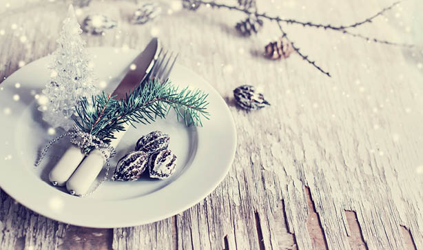 pine cones and garlands at a dinner table