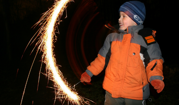 A little boy with a sparkler