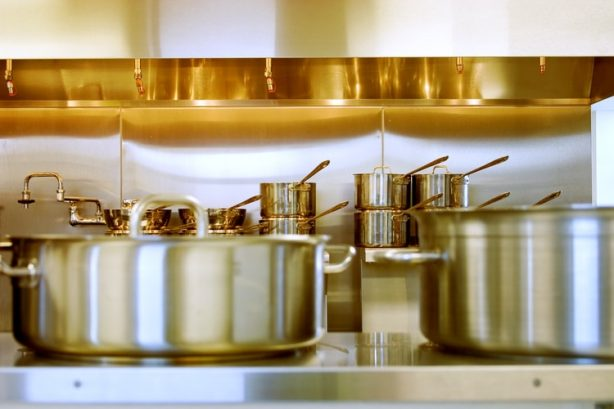 Stainless steel pots in a kitchen setting
